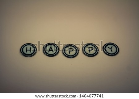 Letters spelling the word 'happy'.