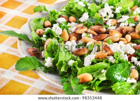 Lettuce, almond and cheese salad, selective focus