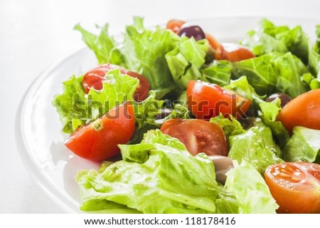 lettuce and tomatoes salad with olives