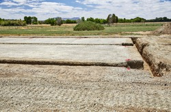 Level building site pad with three foot deep footing trench for a new building
