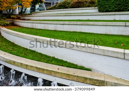 Leveled Terraces With Grass And Fountains In A City Plaza Business Center Urban Landscape