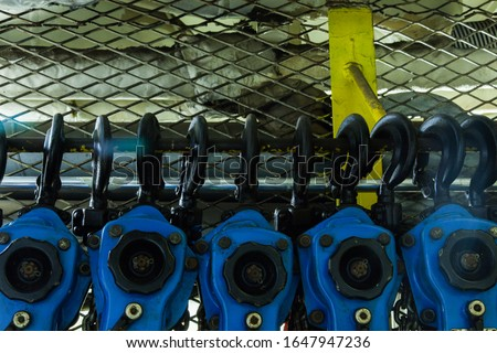 Lever chain hoists at the factory warehouse.
