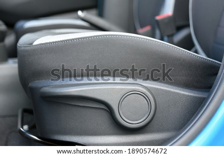 Lever for adjusting the seat position Foto stock ©