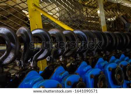 Lever winch. Tal lever. Chain hoists of blue color close-up.