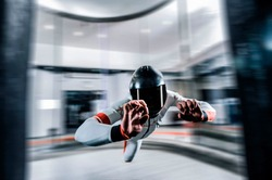 Levitation in wind tunnel. Indoor sky diving. Team flyers. Yoga fly in wind tunnel. Indoor skydiving.