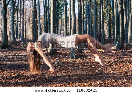 Levitation portrait of young woman in the woods.