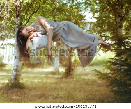 levitation, the sleeping girl in the woods