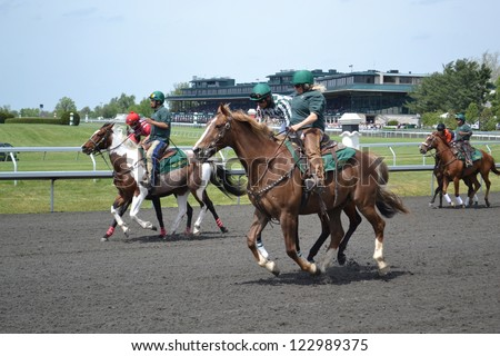 LEXINGTON, KY - AUGUST 10: Jockies warming up their horses before a race at Keeneland Horse Racing Track on August 10, 2011 in Lexington, Kentucky.