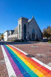 LGBTQ rainbow depicted on a street crosswalk in Gainesville Florida on a sunny day
