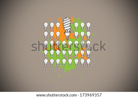 Lgiht bulbs on paint splashes against grey background with vignette
