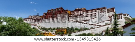 LHASA, TIBET / CHINA - July 31, 2017: Magnificent panorama of Potala Palace. Unesco World Heritage, home of the Dalai Lama, one of the most important pilgrim sites of the Tibetan Buddishm. Spirit. Stock photo ©