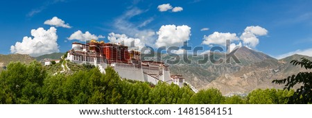 LHASA, TIBET / CHINA - July 31, 2017: Panorama of Potala Palace - home of the Dalai Lama and Unesco World Heritage. Blue sky, clouds. Amazing view of the ancient fortress. Center of Tibetan Buddhism. Stock photo ©