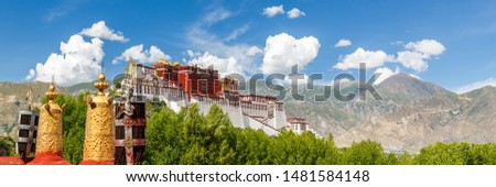 LHASA, TIBET / CHINA - July 31, 2017: Panorama of Potala Palace with golden prayer wheel in the foreground.breathtaking. Unesco World Heritage, Tibetan Buddhism. Stock photo ©