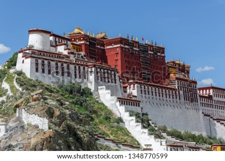LHASA, TIBET / CHINA - July 31, 2017: Side view on Potala Palace during summer. In 1959 the Dalai Lama fled from his home into exile. The palace is a Unesco World Heritage Site since 1994. Stock photo ©