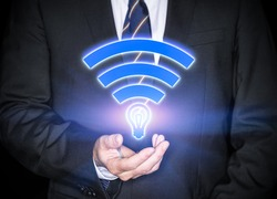 Li-Fi W-Lan technology, internet and networking concept - Young businessman activates Li-Fi High speed connection