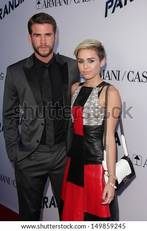 """Liam Hemsworth and Miley Cyrus at the """"Paranoia"""" US Premiere, Directors Guild of America, Los Angeles, CA 08-08-13"""