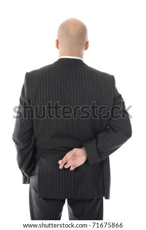 Liar businessman with crossed fingers at back. Isolated on white background
