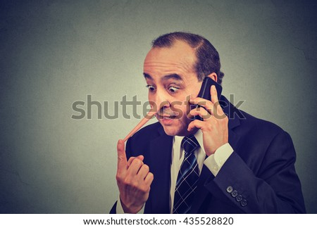 Liar customer service representative. Middle aged man with long nose talking on mobile phone lying isolated gray wall background. Liar concept. Human face expression emotion feeling character traits