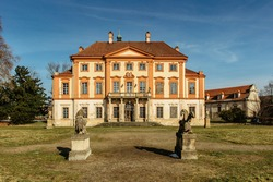 Libechov, old abandoned baroque castle in central Bohemia,Czech republic.Romantic building with balcony,red facade and park.Rebuilt in16th century as Renaissance chateau surrounded by wide water moat