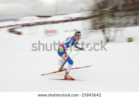 LIBEREC, CZECH REPUBLIC - FEBRUARY 27: Finnish skier Ville Nousiainen runs through the fourth leg of Nordic Ski World Championship Men's Relay 4x10 C/F February 27, 2009 in Liberec, Czech Republic.