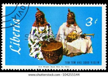LIBERIA - CIRCA 1967: A stamp printed in Liberia shows Tom Tom & Soko Violin series Local Music, circa 1967