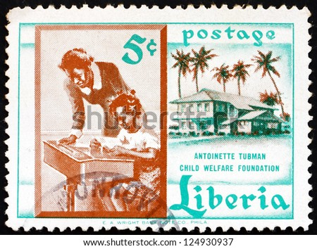 LIBERIA - CIRCA 1957: a stamp printed in the Liberia shows Teacher and Pupil, Founding of the Antoinette Tubman Child Welfare Foundation, circa 1957