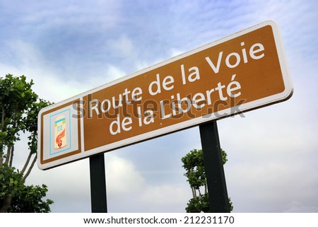 Liberty Road sign - Path of Liberty is the commemorative way marking the victorious route of the Allied forces from D-Day in June 1944. Starts in Ste.-MÃ?¨re-Ã?Â?glise, France and ends in Bastogne, Belgium Photo stock ©