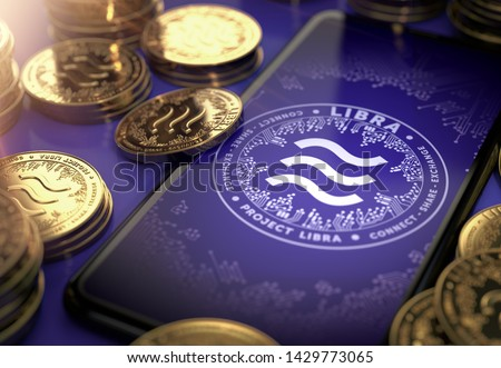 Libra concept coin design on-screen and laying golden Libra concept coins. Libra cryptocurrency in everyday use concept. 3D rendering