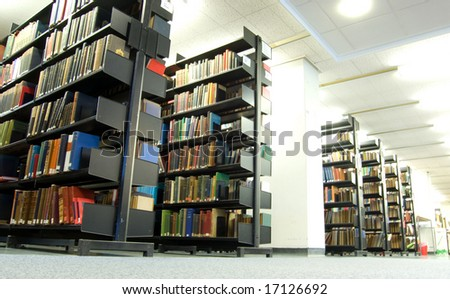 Library bookshelves in university or college - education and knowledge concept