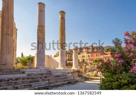 Library of Hadrian in Athens, Greece. It is a famous landmark of Athens. Nice panorama of Ancient Greek ruins among flowers in the Athens center. Scenic view of remains of the antique Athens city.