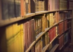 Library or book store with rows of old antique books