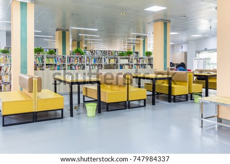 library reading area, some comfortable seat and shelf background