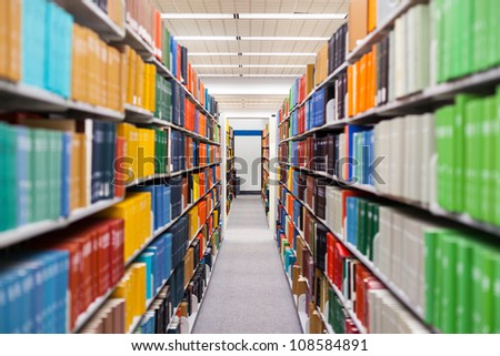 library setting with books and reading material (Please note that many books with legible titles are filler titles that only state the 'type' of materials contained within and date) - stock photo