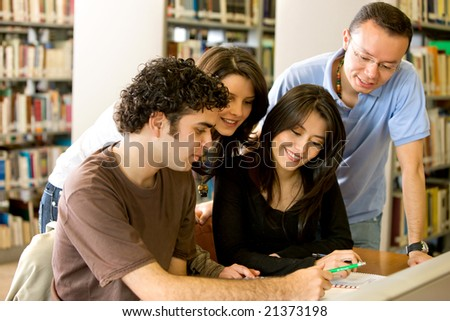 library students smiling and doing group coursework