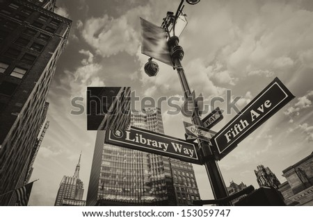 Library Way and 5th Avenue street sign in New York City