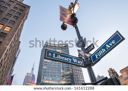 Library Way street sign with skyscrapers at sunset New York City