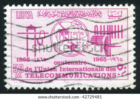 LIBYA - CIRCA 1970: Emblem of the international telecommunication company, circa 1970.