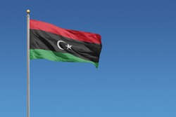 Libya Flag in front of a clear blue sky