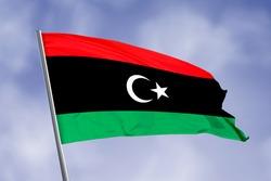 Libya flag isolated on sky background. close up waving flag of Libya. flag symbols of Libya.