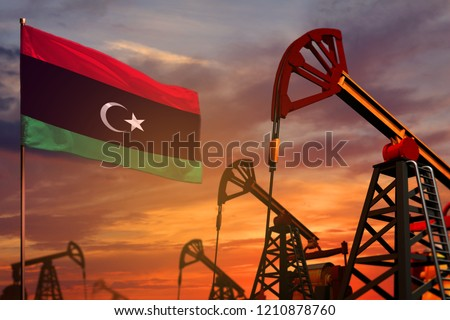Libya oil industry concept, industrial illustration. Libya flag and oil wells and the red and blue sunset or sunrise sky background - 3D illustration Stockfoto ©