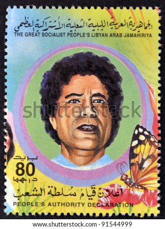 LIBYAN - CIRCA 1995: A Stamp printed in The Great Socialist Peoples Libyan Arab Jamahiriya shows Colonel Muammar Kaddafi, circa 1995