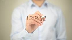 License,  Man writing on transparent screen