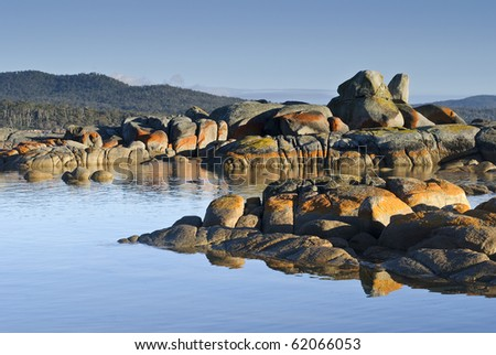Lichen painted rocks and reflections, Binalong Bay, Tasmania
