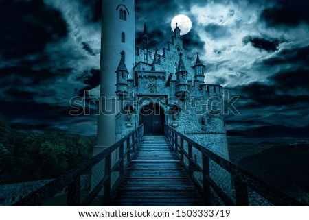 Lichtenstein castle at night, Germany. Old spooky house in full moon. Creepy view of dark mystery mansion. Scary gloomy scene with haunted Gothic castle for Halloween theme. Horror and terror concept.