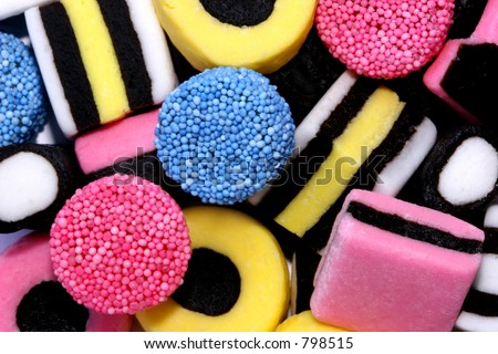 Licorice allsorts sweets forming a background..