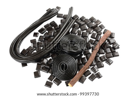 Licorice roots and candies on white background