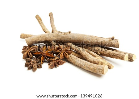 Licorice roots and star anise isolated on white background