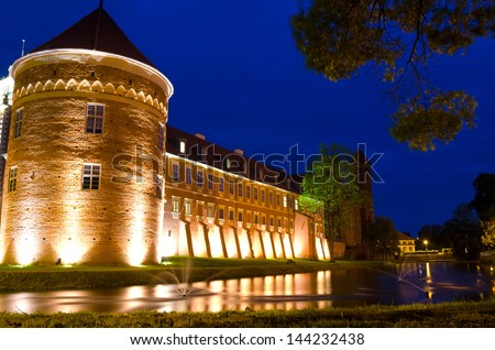 LIDZBARK WARMINSKI CASTLE, POLAND-MAY 23: Modern Krasicki hotel in medieval castle - night view in May 23, 2012 in Poland. Four stars hotel made in XV century castle can accommodate up to 250 guests,
