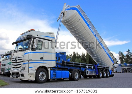 LIETO, FINLAND - AUGUST 31: Mercedes-Benz Actros tipping silo truck on August 31, 2013 in Lieto, Finland. Dry bulk shipping stocks soar in August, and the long-term trend is improving.