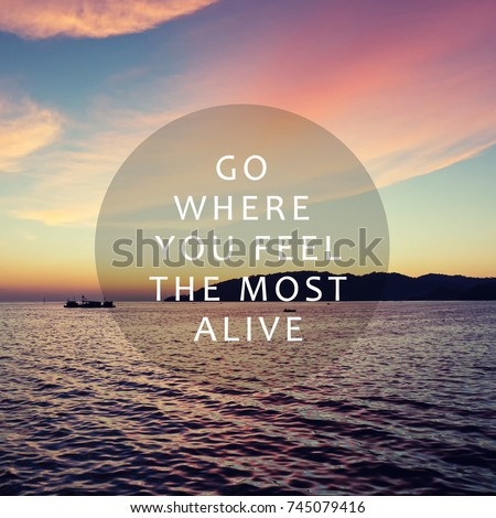 Life and travel inspirational quotes - Go here you feel the most alive. Blurry retro background. #745079416